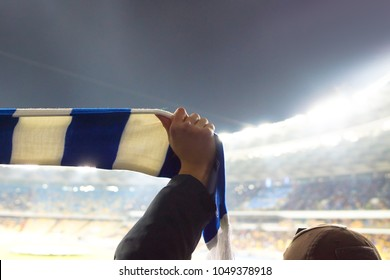 Football fans keep scarves with the color of their clubs