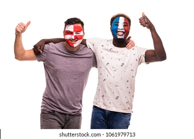 Football fans supporters with painted face of national teams of France and Croatia isolated on white
