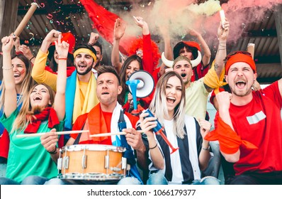 Football fans supporting their team at the arena for the world championship
