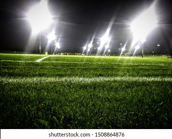 football field lit up at night
