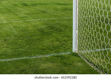 The football field. Mesh football goal.  Soccer goals. Football background.