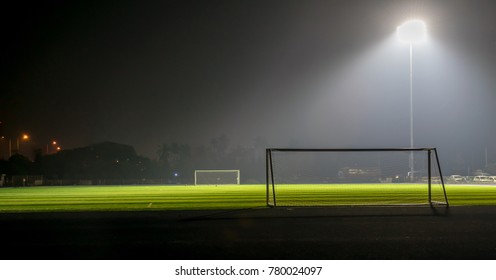 Football field at night and with spotlight