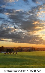 Football field at sunset during fall season