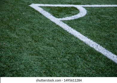 Football fields corner with white stripe and green grass. Field photography.