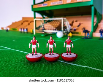 Football figures lined up on a grass field