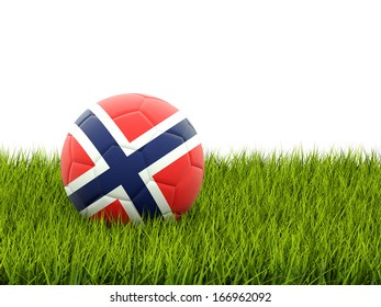 Football with flag of norway on green grass