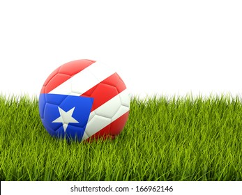 Football with flag of puerto rico on green grass