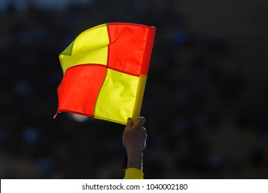 football foul flag on the background of the stands during soccer match