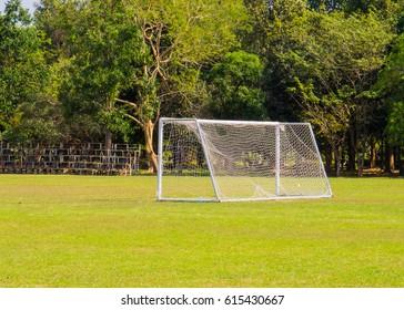 football game goal net on green grass field