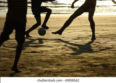 football game on the beach  against the sun