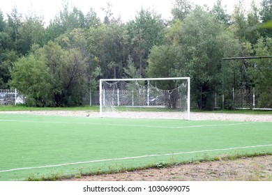 Football gate in a street stadium. Sports summer and autumn background