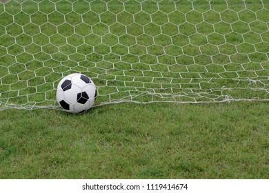 football gates on a green lawn.