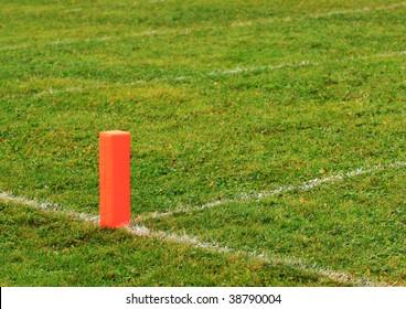 Football goal line orange marker.