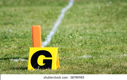 Football goal markers on a grass field.