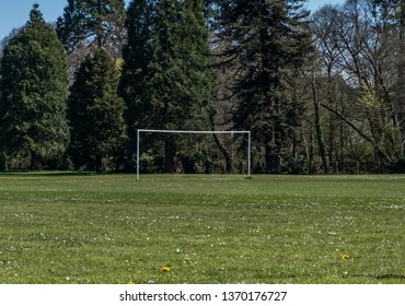 Football goal post in an empty park with no people.