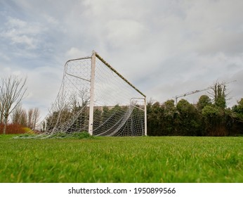 Football goal post on a training ground. Worn out grass on a keeper spot. Soccer theme background