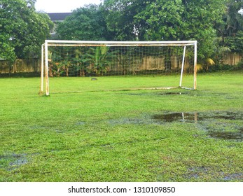 football goal post on the wet field.