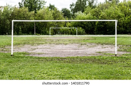 Football goal without grid and the empty football field
