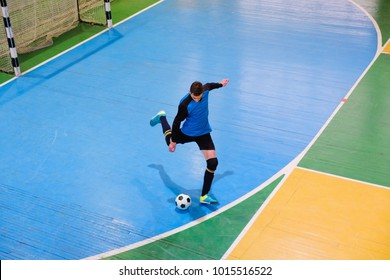 Football goalkeeper on goal, field, Small Futsal ball field in the gym indoor, Soccer sport field