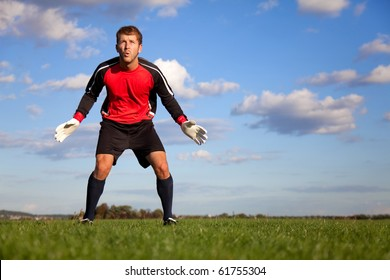 Football goalkeeper ready to catch the ball outdoors