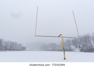 football goalpost and field in falling snow