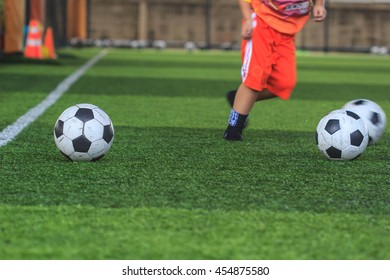 football in green grass with background Training children in Soccer academy