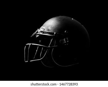 Football helmet on black background.
