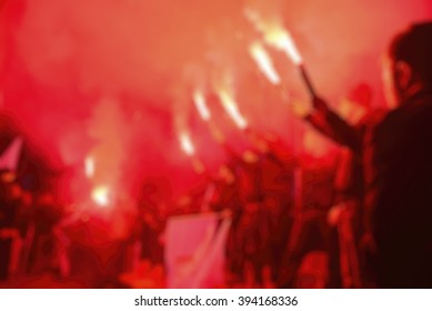 Football hooligans fanatics as a blurred background.