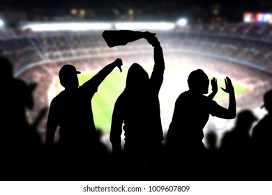 Football hooligans in game. Angry soccer fans shouting and booing in the crowd. Losing team fans got mad. Furious silhouette people complain and protest a mistake made by referee.