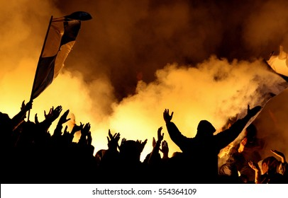 Football hooligans with torches on stadium, fans