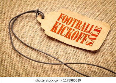 Football Kickoff Sale sign - a paper price tag with a twine iagainst burlap canvas