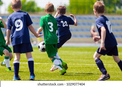 Football Match For Children. Training and Football Soccer School Tournament. Group of Boys Playing Football