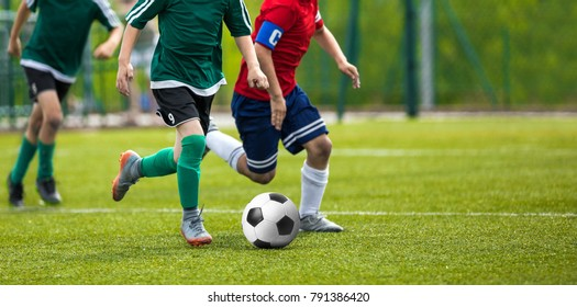 Football match for young players. Training and football soccer tournament for children. Youth soccer competition