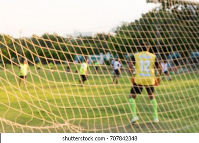 The football net with player on background, net goal of football and blurred player.