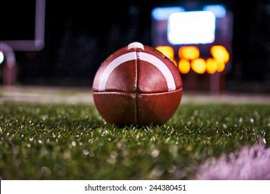 Football on Field with Scoreboard