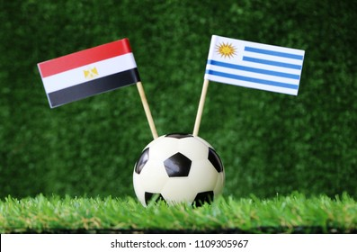 football on Green grass match World cup 2018 Egypt vs Uruguay flag
