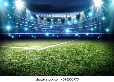 Football pitch with green grass and blue light with free space for your decoration