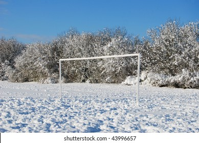 Football pitch (soccer field) in winter snow