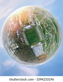 Football planet. Concept with a panorama around the soccer stadium.