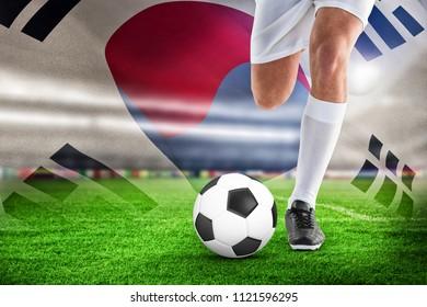 Football player against korea republic flag waving