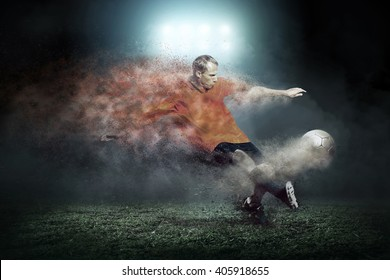 Football player with ball around splash drops on the stadium field