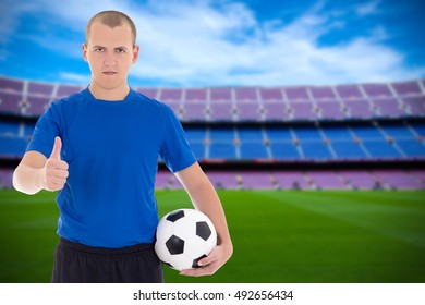 football player with ball on field of big stadium