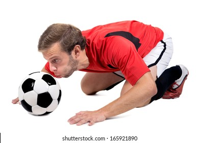 Football player blowing a ball isolated in white