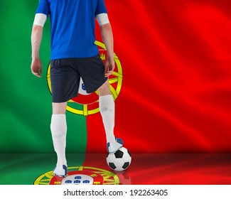Football player in blue jersey against digitally generated portugese national flag