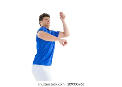 Football player in blue jersey jumping on white background