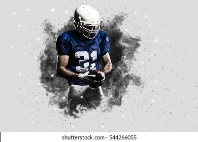 Football Player with a Blue uniform coming out of a blast of smoke .