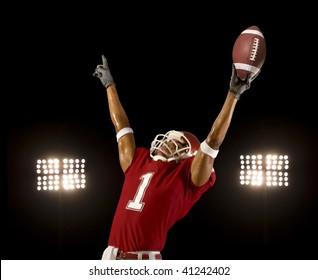 Football player celebrates wining touchdown