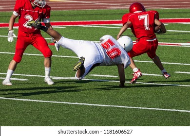 Football player diving for a tackle