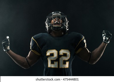 Football player  with his fist raised and yelling