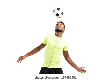 Football player hitting a ball with his head